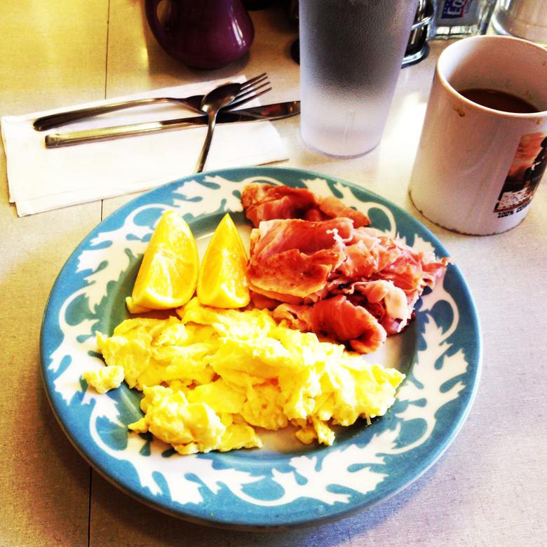 Scrambled eggs and ham, sliced