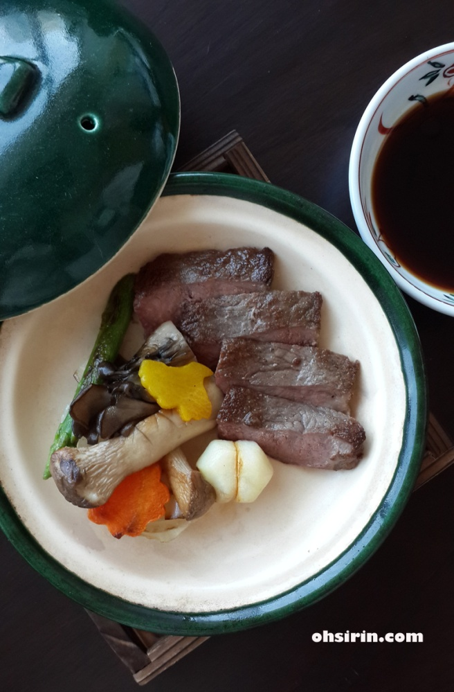 Main dish of grilled Japanese beef with vegetable and steak sauce